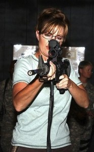 Sarah Palin aiming rifle