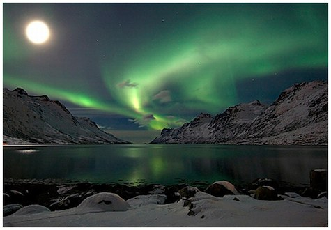 aurora and moon over mountains