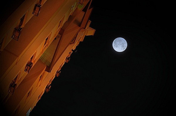 supermoon over high-rise building