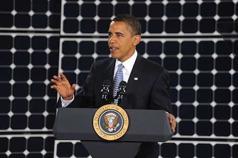 Obama speaking in front of solar panels