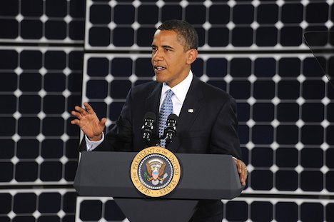 Obama in front of solar panels