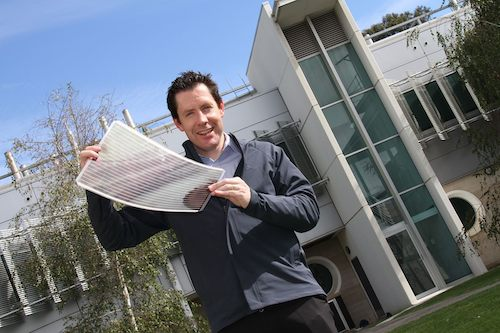 Dr Scot Watkins with a flexible solar cell
