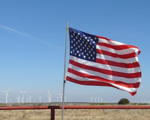 US flag by wind farm